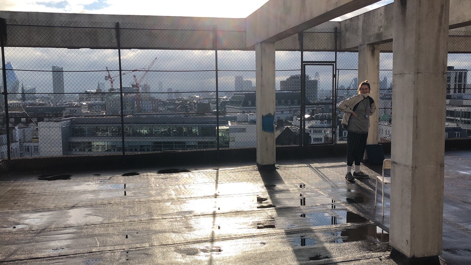 agnes standing on a roof overlooking the city of london