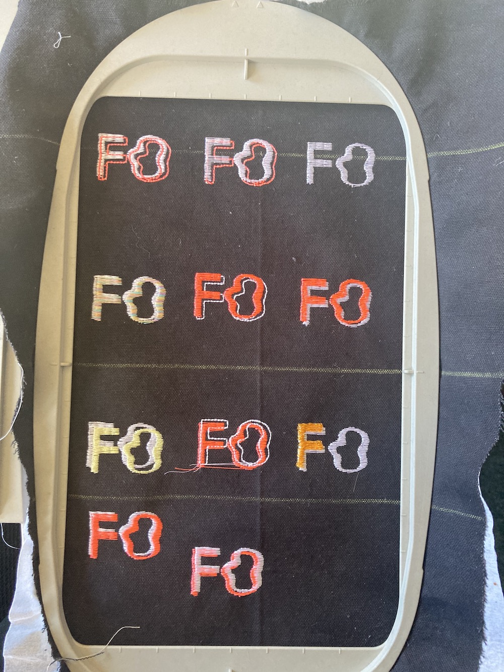 a number of different embroidered logos of the initials F.O.